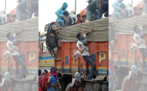 A tragic photo of migrant workers telangana to jarkhand a boy lift baby to truck